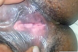 Playing With Her Hairy Ebony Pussy Up Close
