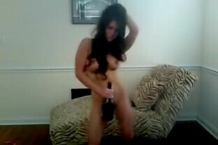 Brunette fucks her shaved pussy with a bottle of wine