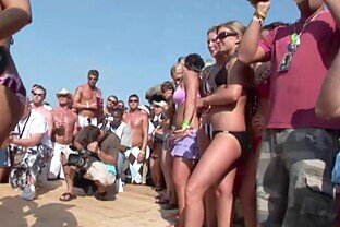 Slutty chicks in bikinis get naughty in public at a party