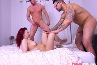 Redhead slut Lydya Moser gets filled up with two big cocks