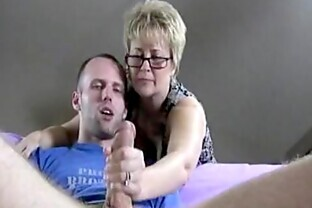 Kinky Mature with Glasses Jerks Off a Younger Cock