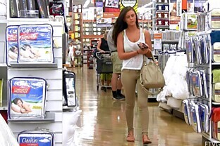 Teen brunette shows her big natural tits in public